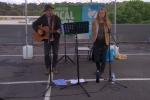 Johnny Cronin and Yani sing folk music.